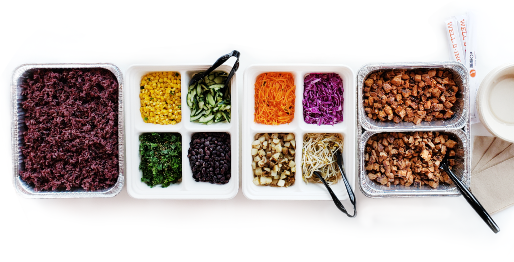 BIBIPACKs in catering pans featuring a purple rice and meat base with 8 of BIBIBOP's most popular toppings