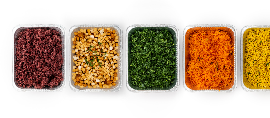 BIBIBOP Traditional Spread featuring catering pans filled with different BIBIBOP bowl options (rice, tofu, kale)